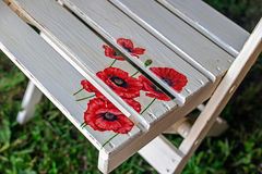Chair painted with poppy flowers Royalty Free Stock Photo
