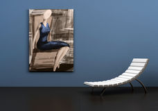 Chair and painting. Painting on a wall behind a white chair Stock Image