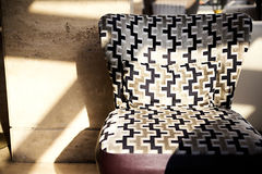Chair with a pattern near the wall royalty free stock photos