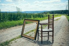 Chair with picture frame in nature Stock Images