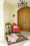 Chair and pillows. Brightly upholstered chair and silk pillows in a corner of an Arabian house Stock Images