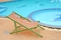 Chair and pool Stock Photos