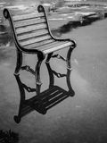 Chair on a rainy day. Empty outdoor chair on a rainy day Royalty Free Stock Images