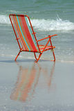 Chair Reflection. Beach chair with reflection in surf. Madeira Beach Florida stock photo