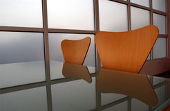 Chair reflection. Chairs and graphic window reflected in a glass table Royalty Free Stock Photo