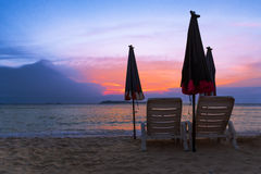 Chair for relax on the beach at sunset Royalty Free Stock Photos
