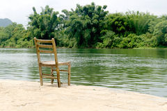 Chair by riverside Royalty Free Stock Photos