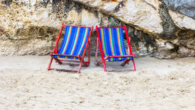 Chair at rock beach Royalty Free Stock Image