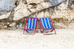 Chair at rock beach Royalty Free Stock Photography