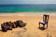 Chair and Rocks on Tropical Beach Royalty Free Stock Image