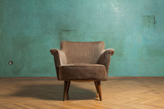 Chair in room. Old chair in grunge room with green wall Royalty Free Stock Photos