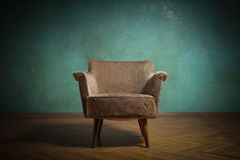 Chair in room. Old chair in grunge room with green wall Royalty Free Stock Photo