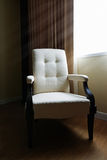 Chair in the room with light Royalty Free Stock Photos