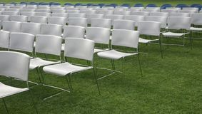 Chair rows and green grass background Royalty Free Stock Photography