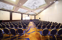 Chair rows in hall Stock Image