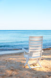 Chair on sand beach. Stock Photo