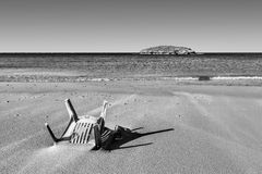 Chair in the Sand of Beach Stock Photos