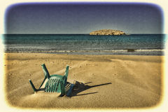 Chair in the Sand of Beach Stock Photo