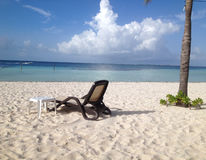 Chair on sandy tropical beach Royalty Free Stock Photo