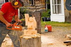 Chair Saw Carving - 5. Man doing chain saw carving stock images