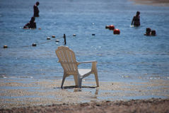 Chair in the sea Stock Images