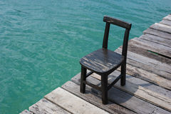 Chair with sea bakground on summer season Stock Images