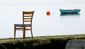 Chair by the sea Royalty Free Stock Image