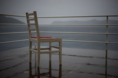 Chair. A chair on a sea platform during a mild storm. Kas, a summer resort in Turkey Royalty Free Stock Image