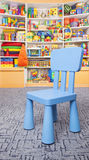 Chair and shelf with toys Stock Photography