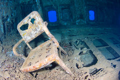 Chair in a shipwreck Stock Photos