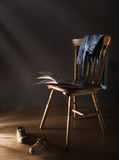 Chair, shoes and book Royalty Free Stock Photos
