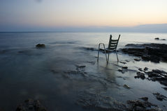 Chair on shore Stock Photos