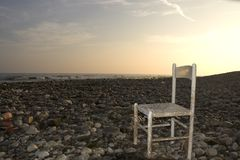 Chair on the shore Royalty Free Stock Images