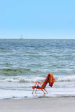 Chair by the shore. Beach chair on Florida Gulf Coast stock photography