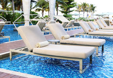 Chair side swimming pool Royalty Free Stock Photos