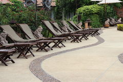 Chair side. Swimming pool chairs in hotel Royalty Free Stock Photos