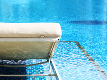 Chair side swimming pool Stock Photo