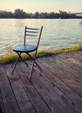 Chair. Sit in a chair by the river Stock Photography