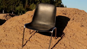 Chair at the site in the middle of the ground Stock Photos