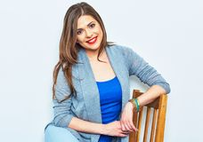 chair sitting smiling woman πρότυπες νεολαίες Στοκ φωτογραφία με δικαίωμα ελεύθερης χρήσης