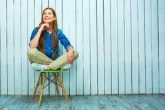 chair sitting smiling woman Στοκ Εικόνα