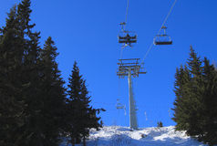 Chair ski lift against blue sky. Chair ski lift against bright blue sky Royalty Free Stock Photography