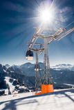 Chair or ski lift in snowy high mountains Stock Images