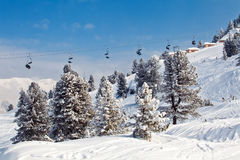 Chair ski lifts with skiers over blue sky. In Mayrhofen, Austria Royalty Free Stock Image