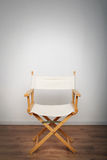 Chair in the spotlight Stock Photo