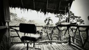 Chair on the 1st Level in Ghost Bungalow in Jungle stock image