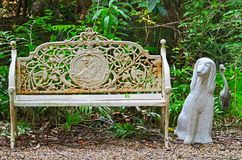Chair and Statue dog Royalty Free Stock Image