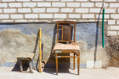 Chair, stool, broom, hose and scoop Royalty Free Stock Photography