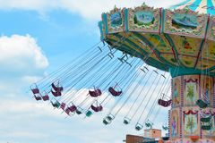 Chair swing ride in motion at funfair stock photos