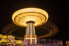 Chair swing spinning in the amusement park Royalty Free Stock Images
